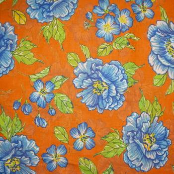 Tecido chitão 100% algodão estampado floral azul claro fundo laranja